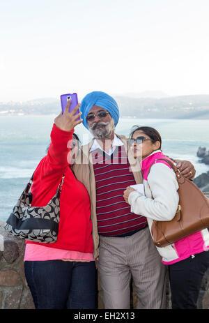 tourists, family, taking selfie, selfie photo, Vista Point, north side of Golden Gate Bridge, city of Sausalito, Sausalito, California Stock Photo