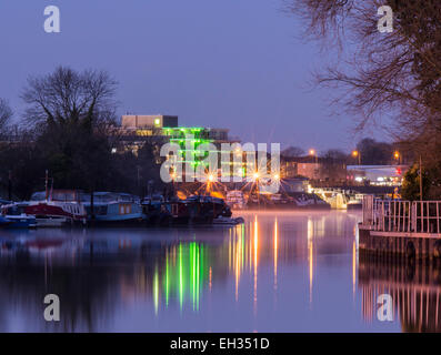 View down the River Thames at Surbiton, Surrey, with the edge of Ravens Ait island - Stock Photo