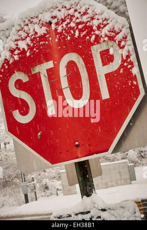 Stop sign in snow, Edison, NJ - Stock Photo