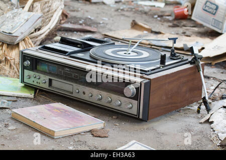 Broken old record player on floor of abandoned Salton Sea building USA - Stock Photo