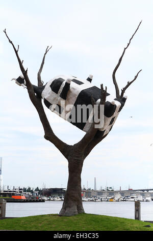 Cow Up a Tree sculpture near Docklands Melbourne Victoria Australia - Stock Photo