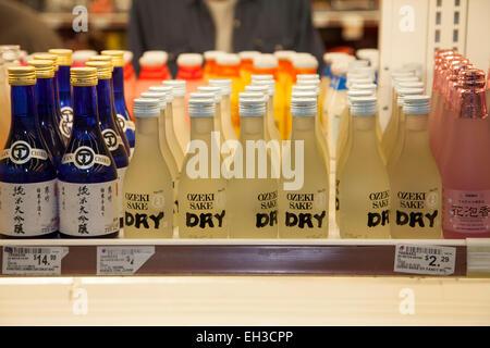 Sake bottles in an Asian market, Richmond, California, USA - Stock Photo