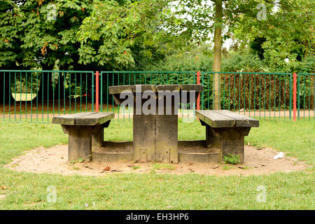 Wooden picnic table and benches in Russell Park, Bedford, Bedfordshire, England - Stock Photo