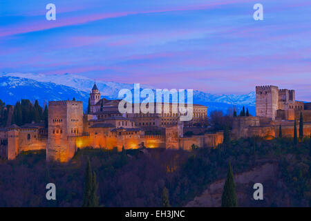 Alhambra, UNESCO World Heritage Site, at dusk, Sierra Nevada, Granada, Andalusia, Spain - Stock Photo