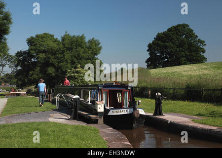 A narrowboat leaving lock 4 of the Grindley Brook flight of locks on the Llangollen canal near Whitchurch, Shropshire - Stock Photo