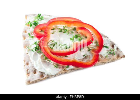 Crispbread with cream cheese, red bell pepper and cress. - Stock Photo
