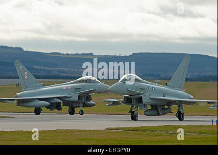 Eurofighter Typhoons ZK322 (BR) and ZK313 (W) preparing for line up on RAF Lossiemouth runway 23, Moray. Scotland. - Stock Photo