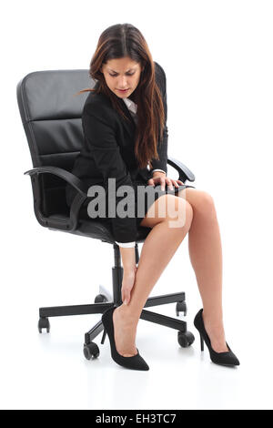 Businesswoman sitting and suffering feet ache isolated on a white background - Stock Photo