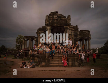 Tourists watch the sunrise at Angkor Wat , Siem Reap , Cambodia. - Stock Photo