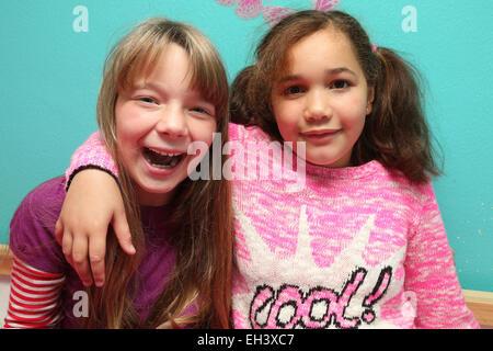 Portrait of girls smiling - model released - Stock Photo