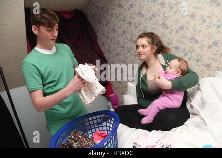 Teenage couple with baby - model released - Stock Photo