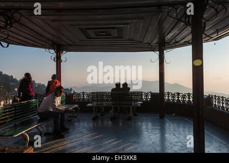 Young Indians enjoying the sunset view over the town of Shimla, Himachal Pradesh, India - Stock Photo