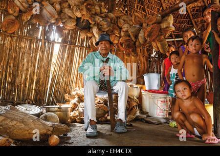 Panama, San Blas archipelago, Kuna Yala, Kunas indigenous community, portrait of a native chief Kuna sat in his - Stock Photo