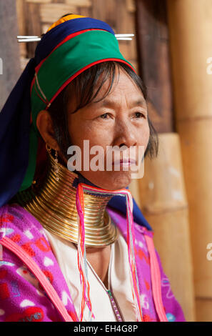 A long necked asian woman of the Kayan tribe who lengthen their necks with brass rings; Inle Lake, Myanmar ( Burma - Stock Photo