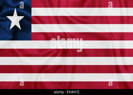 Liberia - Waving national flag on silk texture - Stock Photo