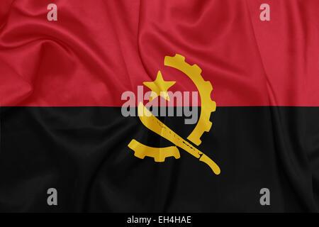 Angola - Waving national flag on silk texture - Stock Photo
