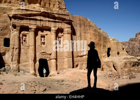 Jordan, Nabataean archeological site of Petra, listed as World Heritage by UNESCO, silhouette of a woman watching - Stock Photo