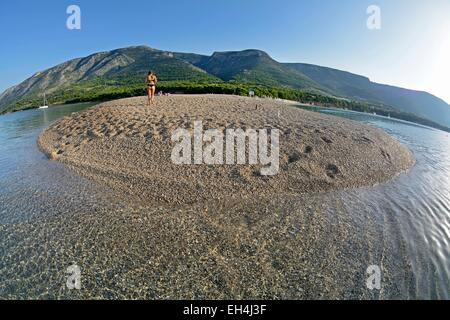 Croatia, Island Brac, beach Golden Horn popular with sunbathers in summer - Stock Photo
