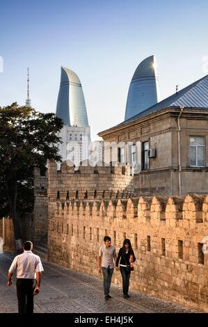 Azerbaijan, Baku, street and fortification walls of the Old City listed as World Heritage by UNESCO, the Flame Towers - Stock Photo
