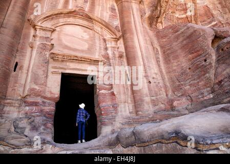 Jordan, Nabataean archeological site of Petra, listed as World Heritage by UNESCO, woman at the entrance of the - Stock Photo