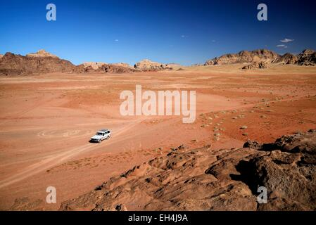 Jordan, Wadi Rum desert, protected area listed as World Heritage by UNESCO, car, red sand desert and rocks - Stock Photo