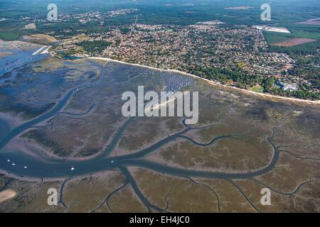 France, Gironde, Ares, Bassin d'Arcachon at low tide and the seaside resort (aerial view) - Stock Photo