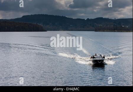 France, Haute Vienne, Vassiviere lake, motor boat on the calm waters of a winter boating lake on a cloudy day - Stock Photo
