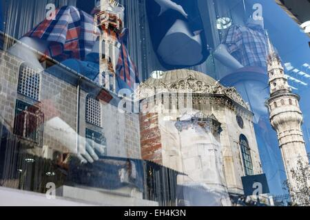 Turkey, Istanbul, Mercan, reflection of a mosque in the window of a shirt menswear stores - Stock Photo