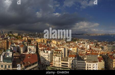 Turkey, Istanbul, Beyoglu, Galata, urban landscape of Istanbul district at sunset on a stormy sky - Stock Photo