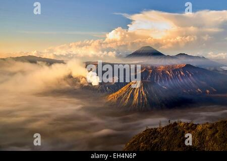 Indonesia, Java, Jawa Timur, Bromo-Tengger-Semeru National Park, sunrise over the volcanoes viewed from mount Penanjakan - Stock Photo