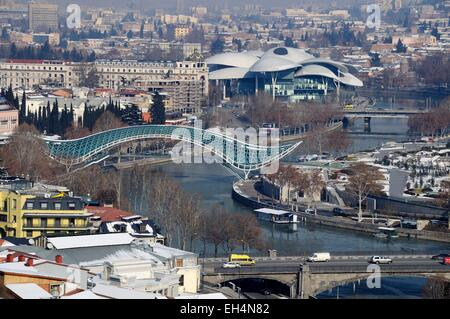 Georgia, Caucasus, Tbilisi, the Peace Bridge on the Mtkvari river in winter - Stock Photo