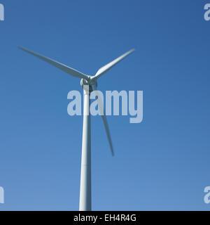 Wind turbine and blue sky - Stock Photo