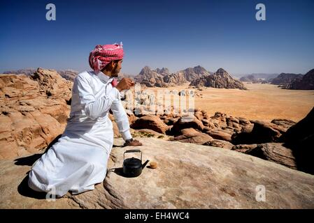 Jordan, Wadi Rum desert, protected area listed as World Heritage by UNESCO, Bedouin having a tea break at the top - Stock Photo