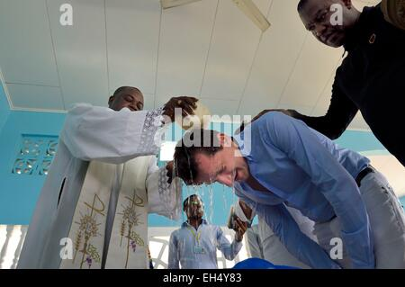 Gabon, Libreville, St. Mary's Cathedral, baptism of an adult man - Stock Photo
