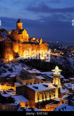 Georgia, Caucasus, Tbilisi, the old town with the mosque, the Narikala fortress and Saint Nicholas church in a winter - Stock Photo
