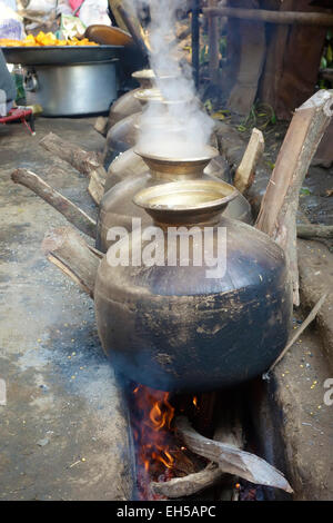 Indian cook prepare food in traditional Indian village marriage,Himachal Pradesh,India - Stock Photo