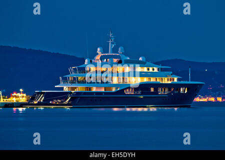 Luxury yacht blue evening view on mediterranean coas - Stock Photo