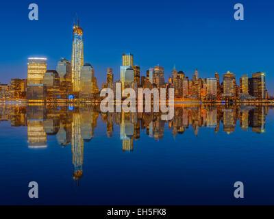 Lower Manhattan skyline at night reflected in water