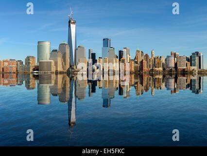 Lower Manhattan skyline reflected in water