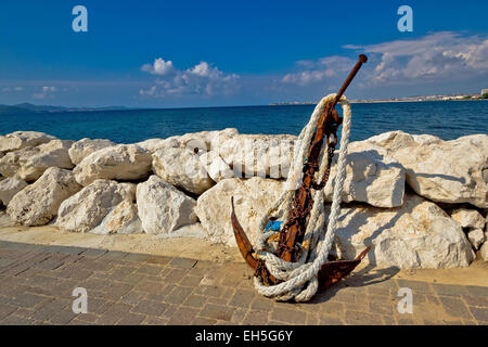 Old rusty anchor by the sea in Dalmatia, Croatia - Stock Photo