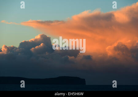 Cumulonimbus cloud over Dunnet Head at sunset, Caithness, Scotland, UK.  From St. John's Point, near the village - Stock Photo