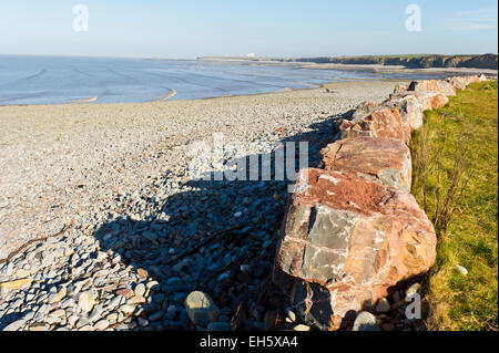 Stones and slabs at low tide on Lilstock beach, Somerset. - Stock Photo