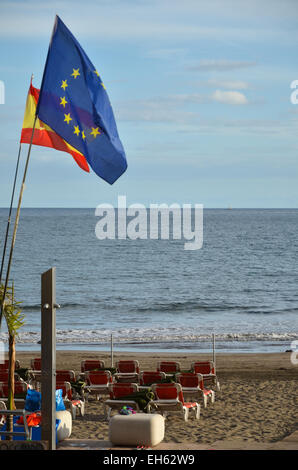 Colorful flags at the beach by the resort San Augustin at the island Gran Canaria in Spain - Stock Photo