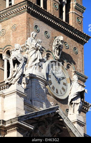 Statues on top of Saint Mary Major Basilica in Rome, Italy - Stock Photo