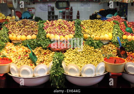 Market stall selling fresh olives in Marrakech, Morocco - Stock Photo