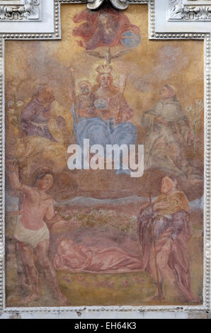 Virgin Mary with baby Jesus and Saints, fresco painting on the house facade in Graz, Styria, Austria on January - Stock Photo