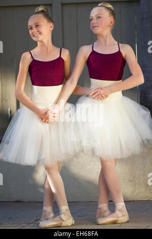 Two cute ballerinas getting ready for their recital - Stock Photo
