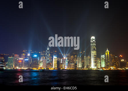 Spectacular sound and light show on Hong Kong Harbour at night. Viewed from Tsim Sha Tsui promenade in Kowloon - Stock Photo