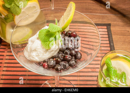 Blueberrys and quark with mint, standing in a glass on a tablet - Stock Photo