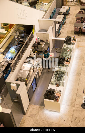 An aerial view of a coffee shop closing for the evening in the Trafford Centre, Manchester, UK - Stock Photo